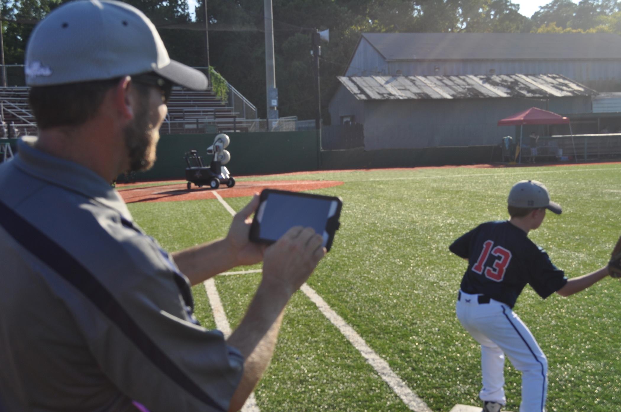 Coach using wireless controller coaching players